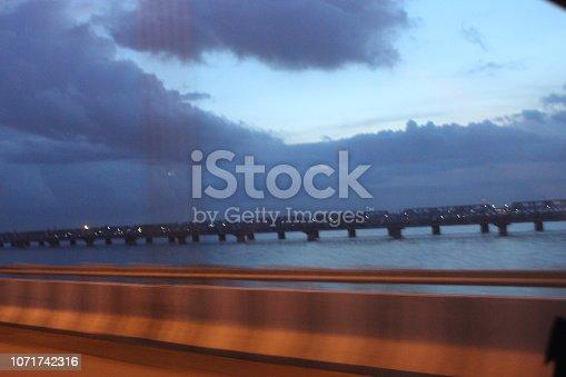 539234032 istock photo evening street lights,vehicles,highway, dusk, motion blurr and cloud sky 1071742316