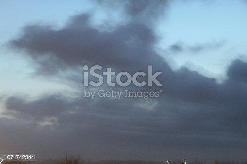 539234032 istock photo evening street lights,vehicles,highway, dusk, motion blurr and cloud sky 1071742344