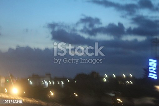 539234032 istock photo evening street lights,vehicles,highway, dusk, motion blurr and cloud sky 1071742348