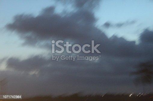 539234032 istock photo evening street lights,vehicles,highway, dusk, motion blurr and cloud sky 1071742364