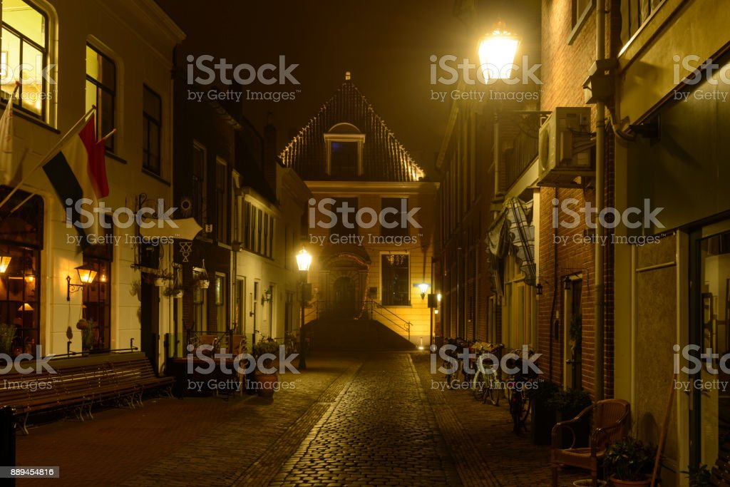 Evening street view in Kampen, Overijssel, during a foggy winter night stock photo