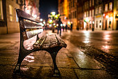 Image of Evening street with benches and lanterns. Night European city