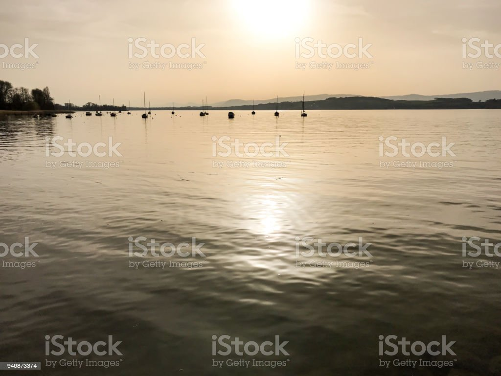 evening sun and light over lake stock photo