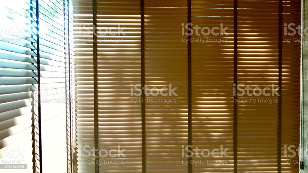 Evening sun light outside wooden window blinds, sunshine and shadow...
