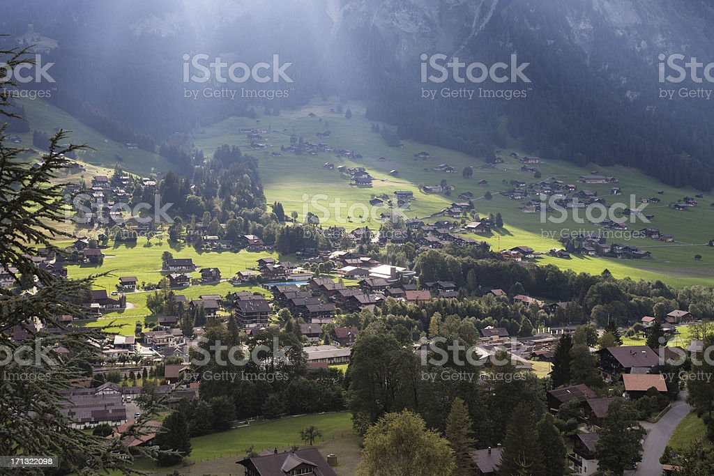 Evening Sunlight over Swiss Village, Lenk, Bernese Oberland royalty-free stock photo