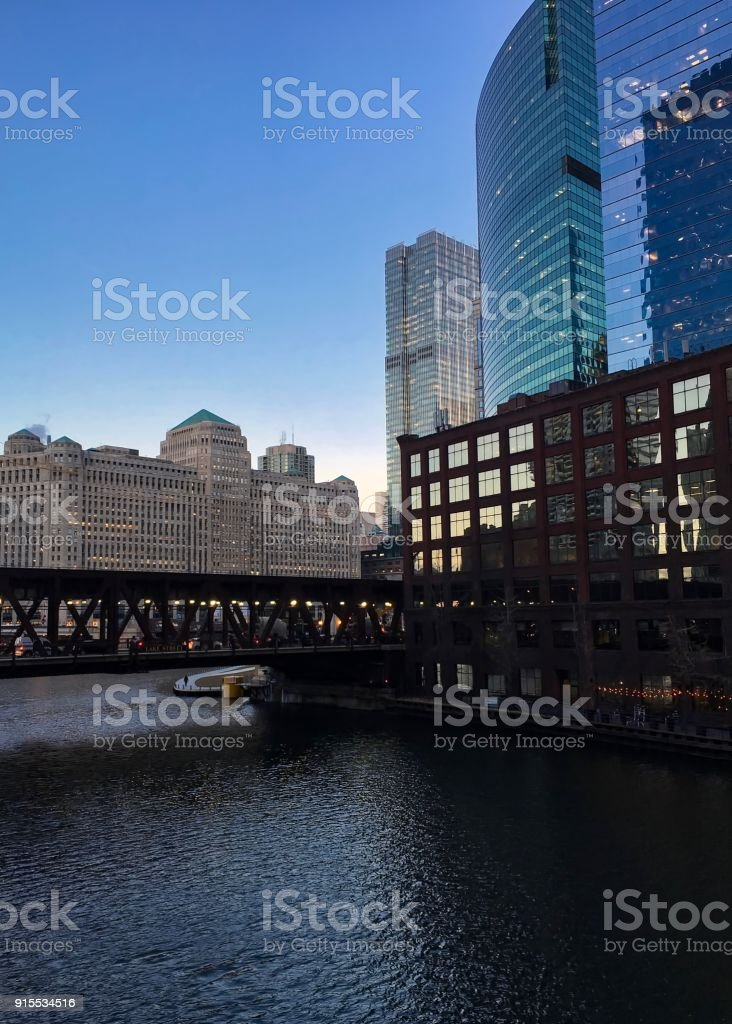 Evening sunset in winter reflects over Chicago River and Lake Street's elevated track. stock photo