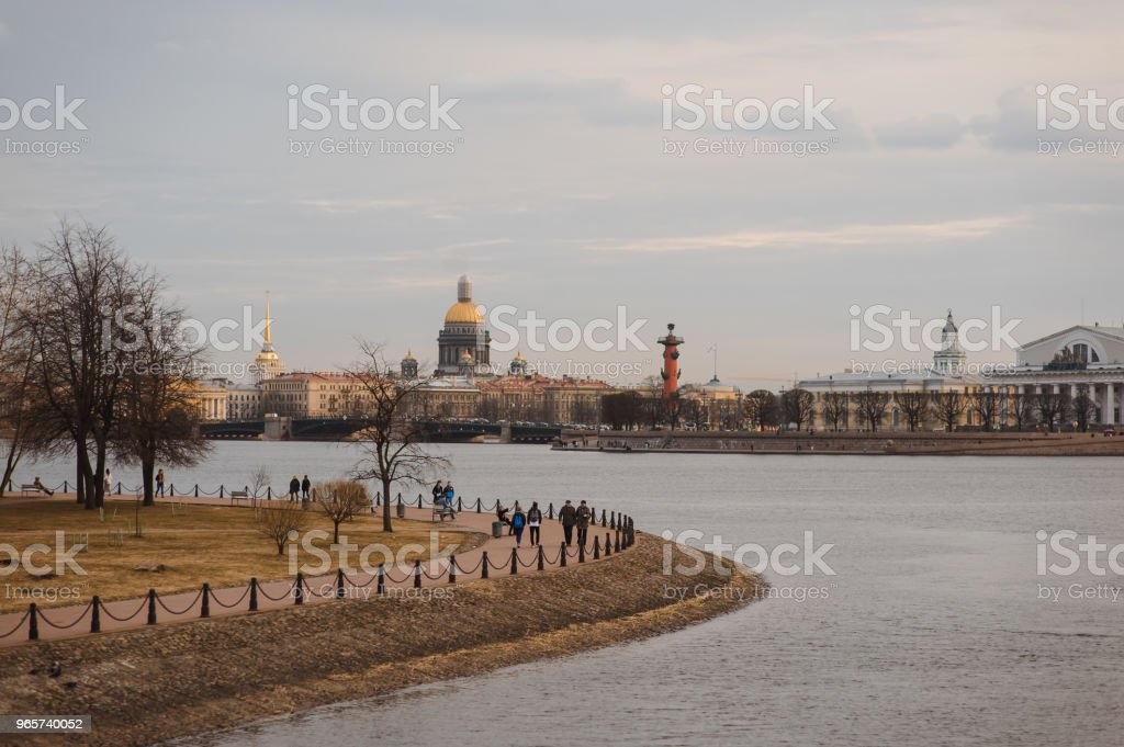 Evening sunset Panorama of St Petersburg, Russia, with Palace bridge over Neva river, golden dome of St Isaac cathedral, Admiralty building and Rostral Column - Royalty-free Architectural Dome Stock Photo