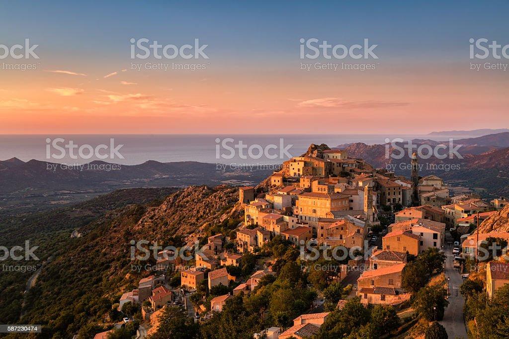 Evening sunshine on mountain village of Speloncato in Corsica stock photo