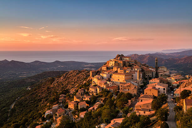 evening sunshine on mountain village of speloncato in corsica - village stock pictures, royalty-free photos & images