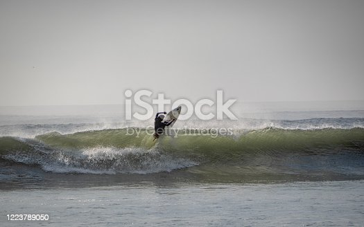 Surfer jumping off a wave in Huanchaco in Peru