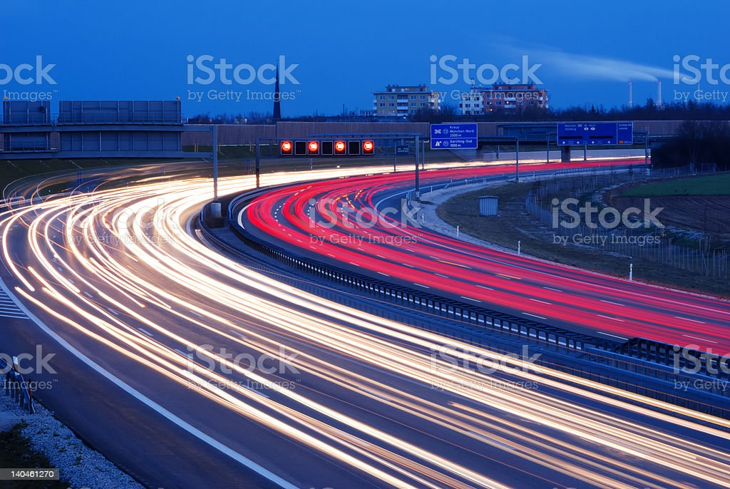 evening traffic during rush hour at Munich, Germany, motion blur stock photo