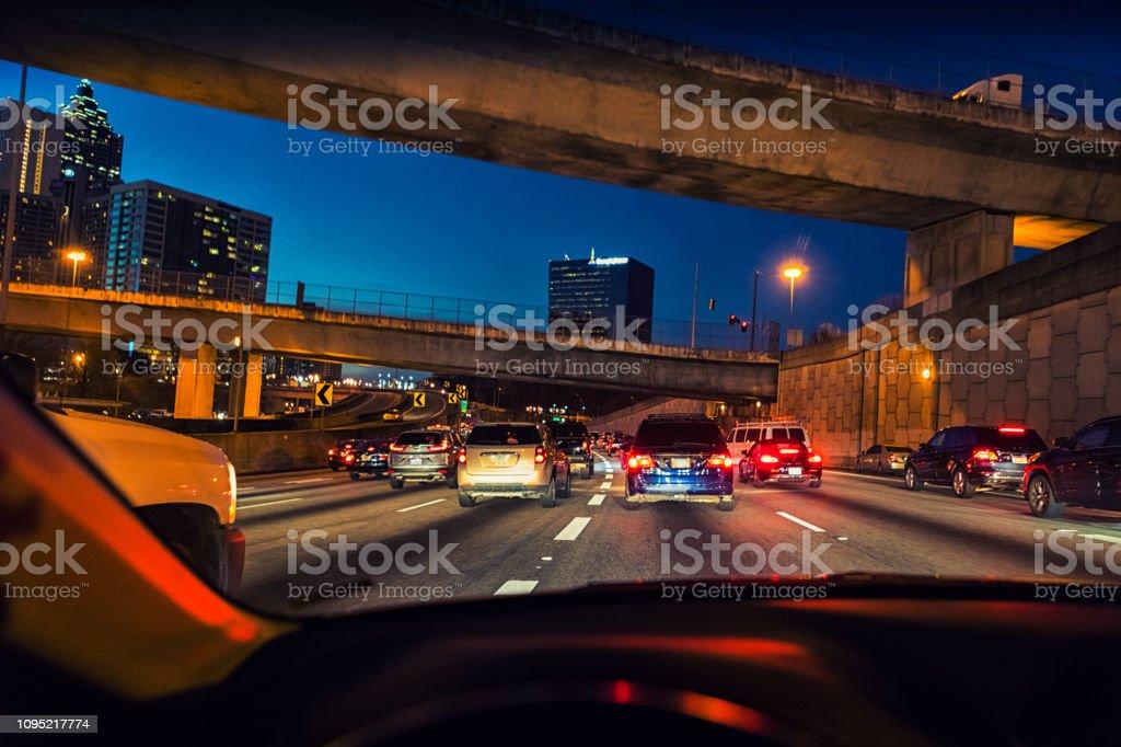 evening traffic flowing through downtown Atlanta stock photo