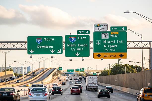 evening traffic on highway, miami, usa - airport pickup stockfoto's en -beelden