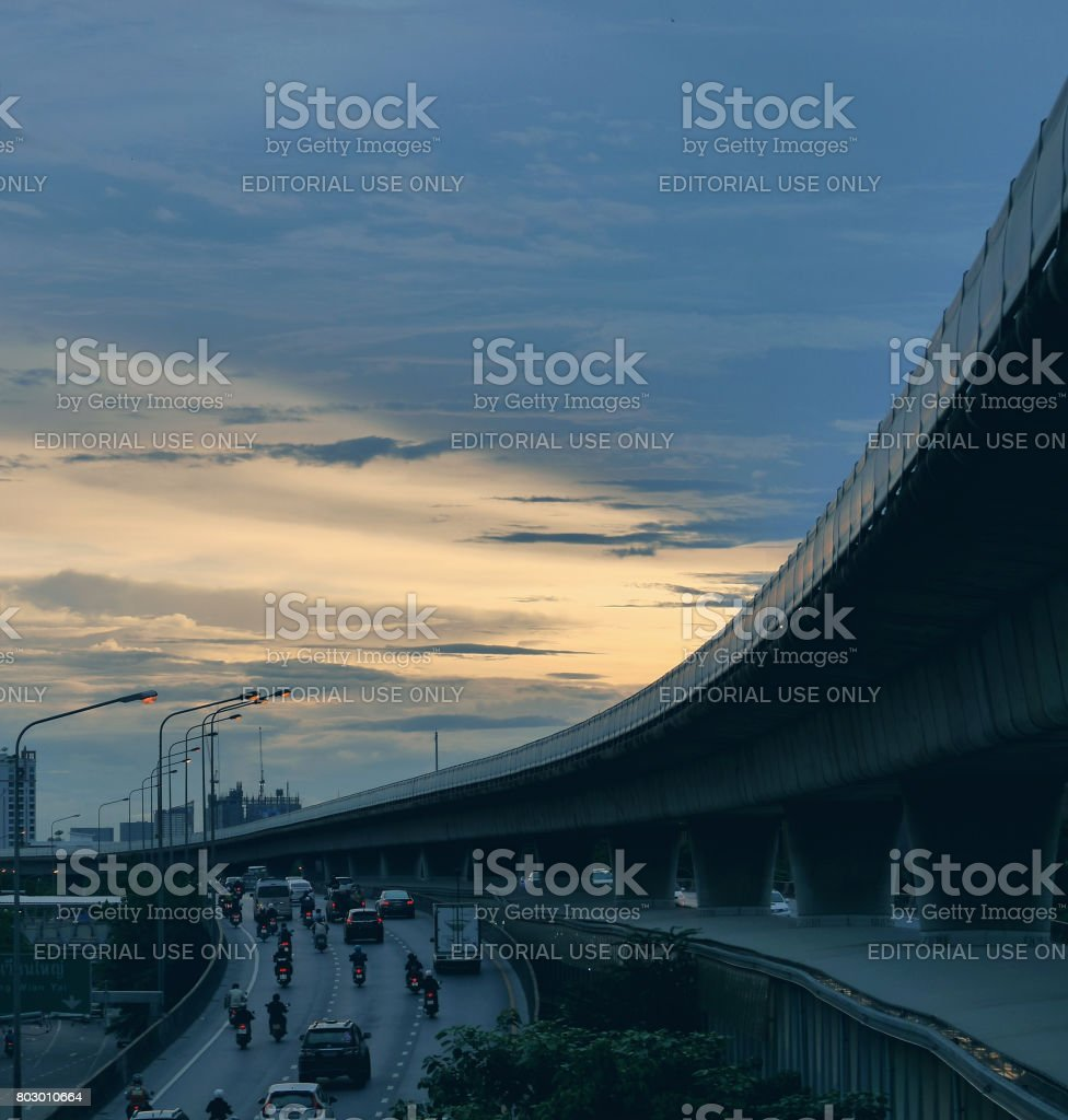 Evening traffic scene of people going home from work at twilight time with beautiful sky lighting stock photo