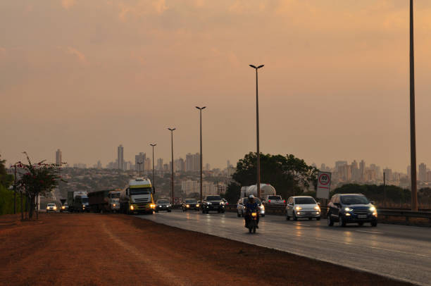 Evening traffic with Goiania cityscape Evening traffic with Goiania cityscape goiás city stock pictures, royalty-free photos & images