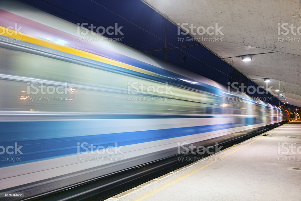 Evening train in motion royalty-free stock photo