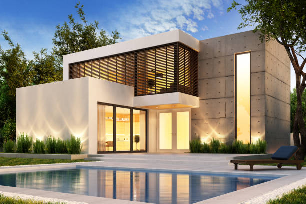 Evening view of a modern house with swimming pool Evening view of a modern house with pool holiday villa stock pictures, royalty-free photos & images