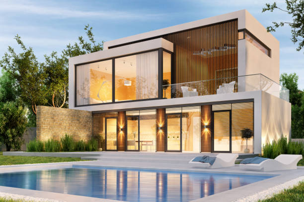 Evening view of a modern large house with swimming pool Evening view of a modern large white house with swimming pool modern house stock pictures, royalty-free photos & images