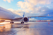 istock Evening view of a passenger plane wing with engine. 1280560822