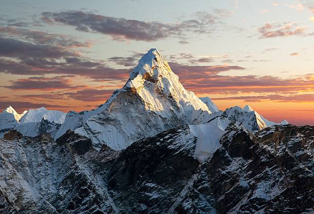 Evening view of Ama Dablam Evening view of Ama Dablam on the way to Everest Base Camp - Nepal atmospheric mood stock pictures, royalty-free photos & images