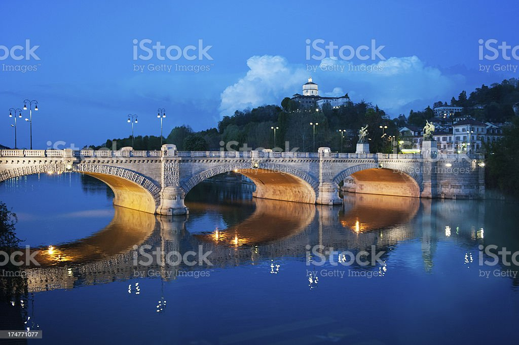 Evening view of an italian bridge from the Po river stock photo