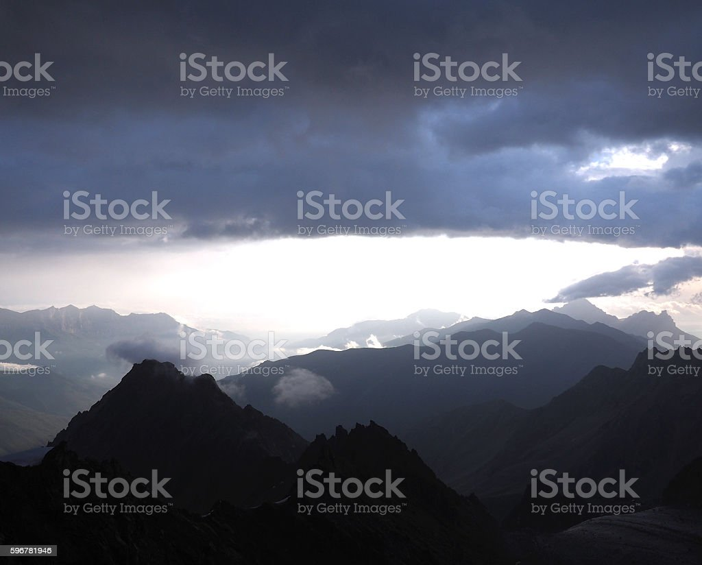 Evening view of blue mountain ranges in the haze. clouds stock photo