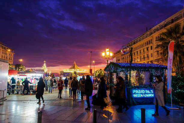Evening view of crowd around festive installments at the main city square. stock photo