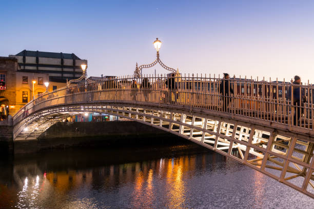 Evening view of famous Ha'penny Bridge in Dublin