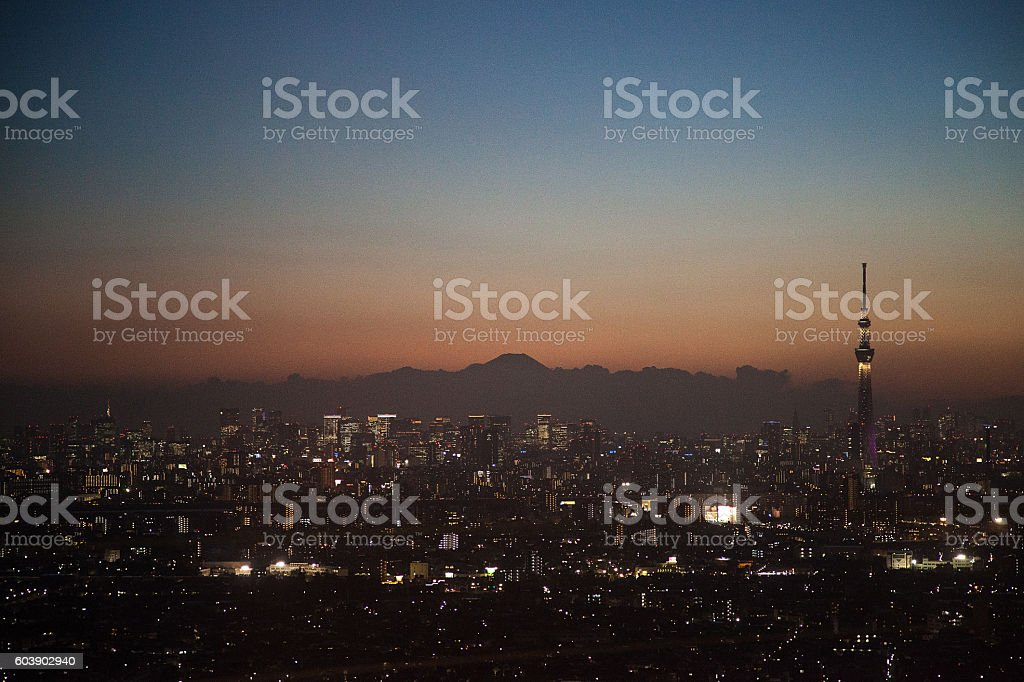 Evening view of High-rise building and Tokyo Skytree and Mount Fuji stock photo