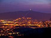 istock Evening view of illuminated Liberec city and Jested Mountain. Night scene 942673968