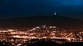 istock Evening view of illuminated Liberec city and Jested Mountain. Night scene 986100722