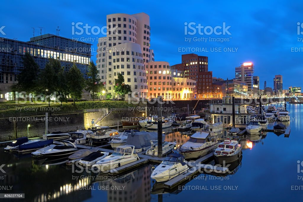Evening view of Media Harbor with Neuer Zollhof buldings in Dusseldorf, Germany stock photo