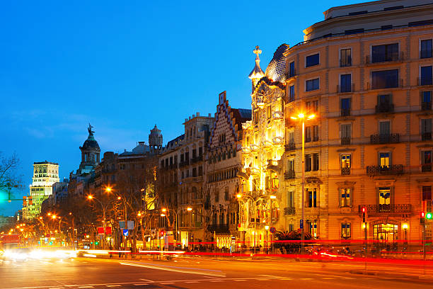 Evening view of Passeig de Gracia in Barcelona, Catalonia Evening view of Passeig de Gracia in winter time. Barcelona, Catalonia passeig de gracia stock pictures, royalty-free photos & images