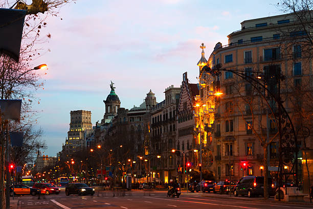 Evening view of Passeig de Gracia in Barcelona Evening view of Passeig de Gracia in winter time. Barcelona gracia baur stock pictures, royalty-free photos & images