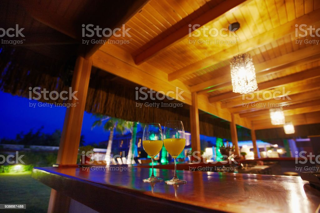 Evening view of small cozy boutique hotels restaurant and pool bar