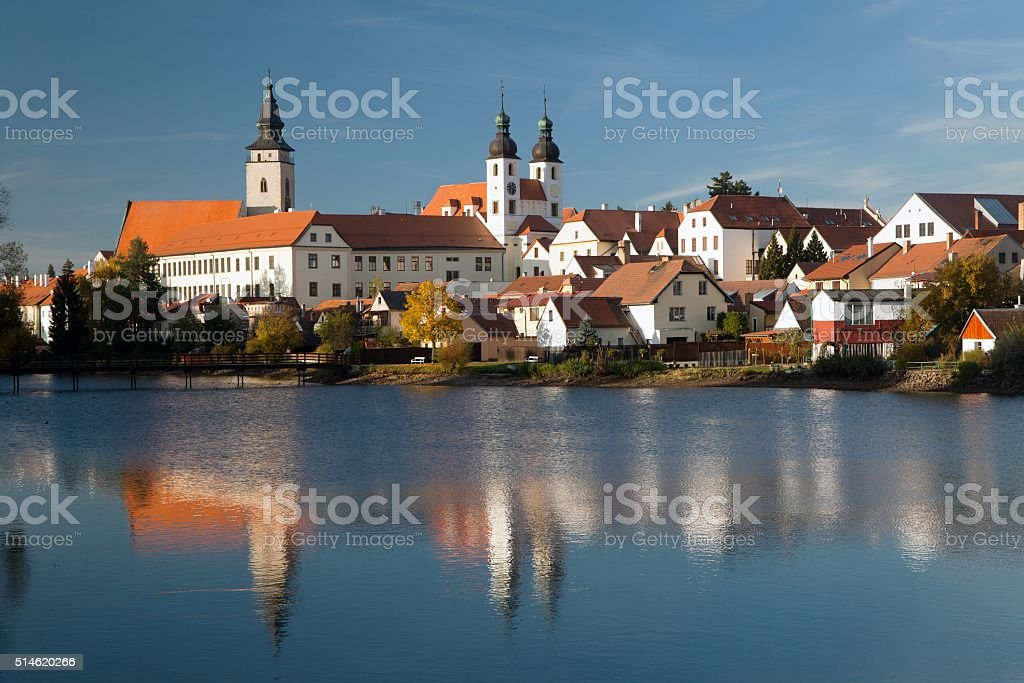 Evening view of Telc or Teltsch town mirroring in lake stock photo