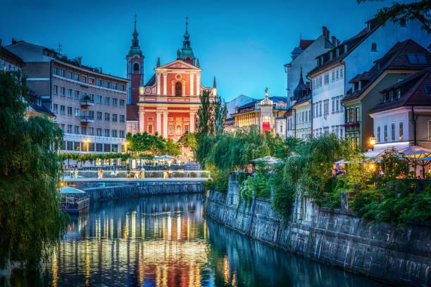 Evening view of the bridge and Ljubljanica river in the city center. Ljubljana, capital of Slovenia. stock photo