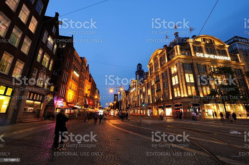 Evening view of the Damrak in Amsterdam royalty-free stock photo