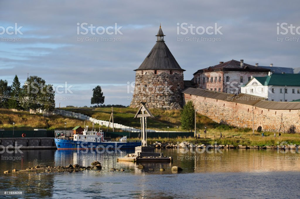 Evening view of the Solovetsky Spaso-Preobrazhensky monastery and the boat. White sea, Russia, Solovki island stock photo