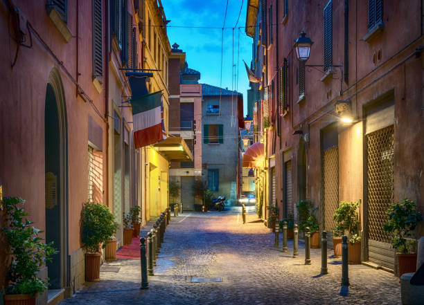 Evening view of Via de' Fusari street, Bologna, Italy. stock photo