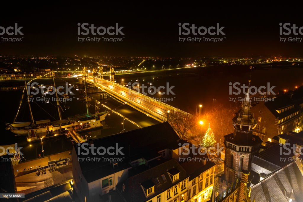 Evening view on Kampen in Overijssel, with the city bridge crossing the river IJssel stock photo