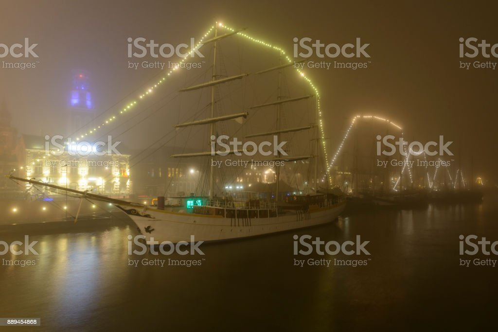 Evening view on the skyline of Kampen in Overijssel, during a foggy night stock photo