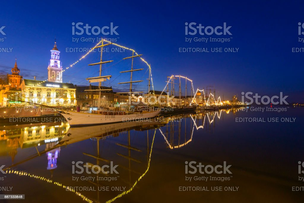 Evening view on the skyline of Kampen with the classic sailing ship Stedemaeght stock photo