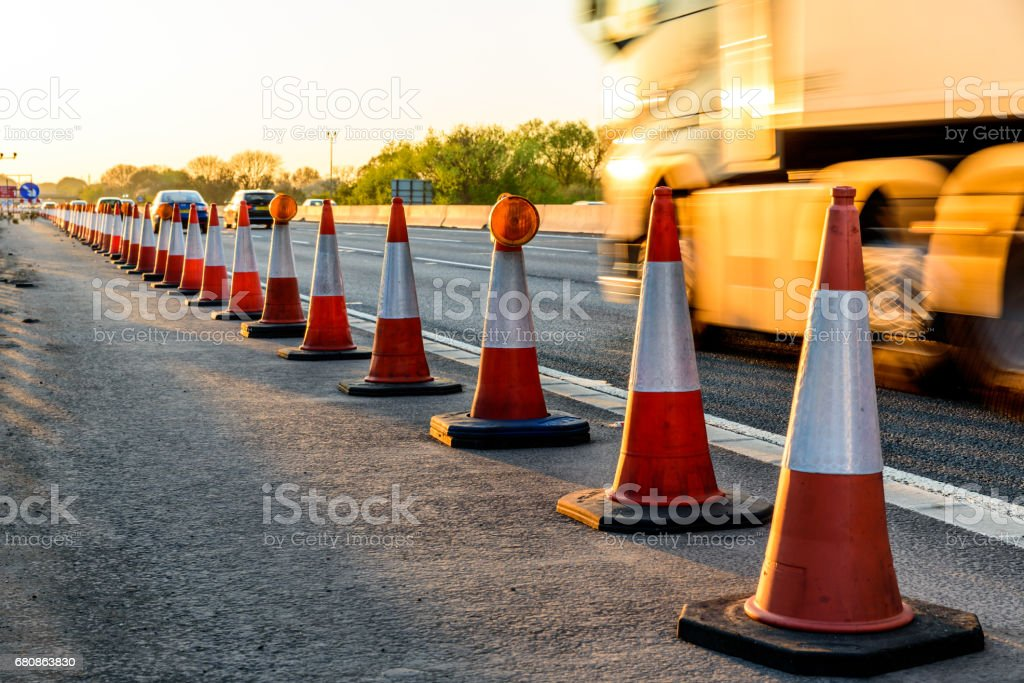Evening view UK Motorway Services Roadworks Cones stock photo