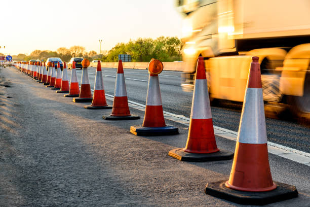 Evening view UK Motorway Services Roadworks Cones Evening view UK Motorway Services Roadworks Cones. multiple lane highway stock pictures, royalty-free photos & images