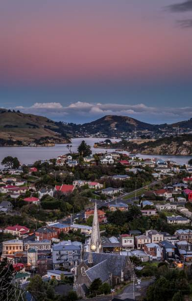Evening views over town of Port Chalmers, Dunedin, Otago NZ stock photo