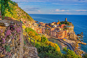 Elevated view from the hiking path on Vernazza, Cinque Terre, at a beautiful late summer afternoon.