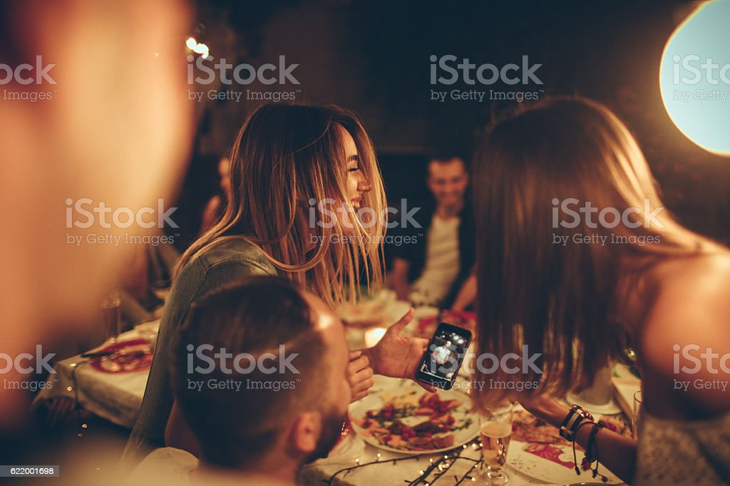 Evening with friends in a bistro stock photo