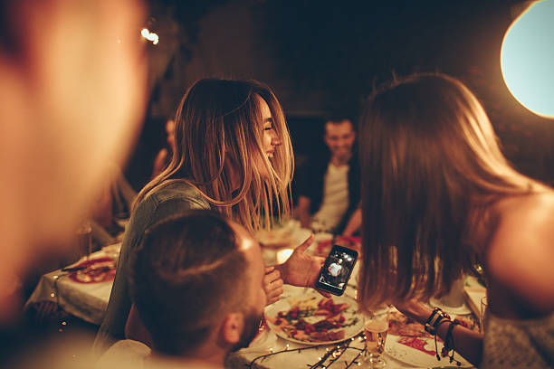 evening with friends in a bistro - eating technology stock photos and pictures