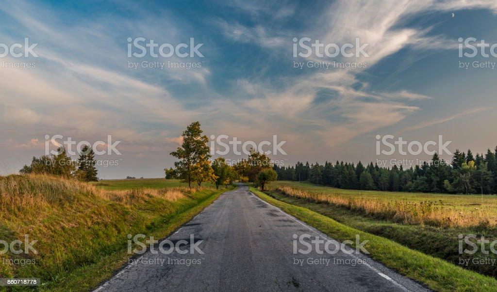Evening with road in Slavkovsky les national park stock photo